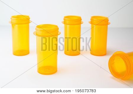 Shallow depth of field on prescription (Rx) drug vials on a white background.  Suitable for healthcare, insurance, wellness, or addiction.
