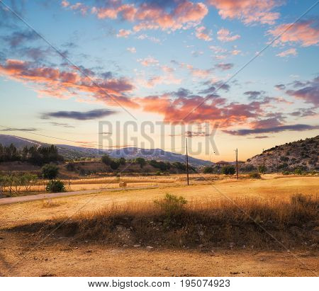 Sunset at cyprus autumn fields with gorgeous sky