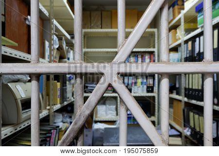 Old folder storage room seen through bars