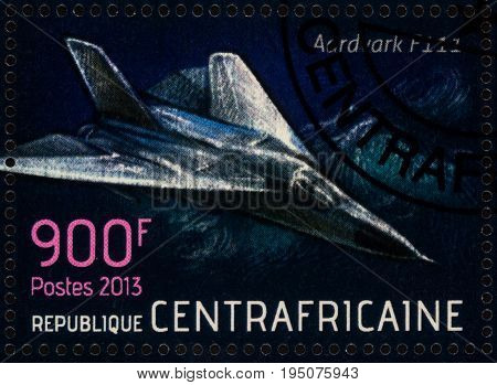 Moscow Russia - July 12 2017: A stamp printed in Central African Republic shows American aircraft General Dynamics F-111 Aardvark - tactical bomber series