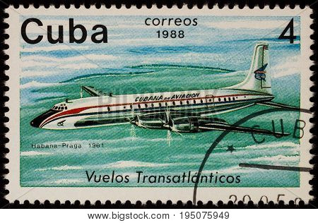 Moscow Russia - January 17 2017: A stamp printed in Cuba shows passenger airliner Douglas DC-7 Airline Havana-Prague (1961) series