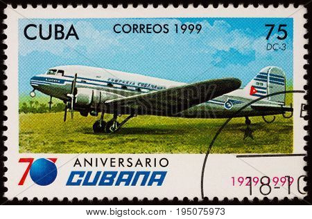 Moscow Russia - July 11 2017: A stamp printed in Cuba shows passenger aircraft Douglas DC-3 series