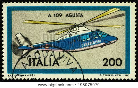 Moscow Russia - July 12 2017: A stamp printed in Italy shows Italian multipurpose helicopter Agusta A.109 series