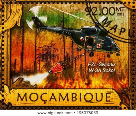 Moscow Russia - July 11 2017: A stamp printed in Mozambique shows Polish helicopter PZL-Swidnik W-3A Sokol extinguishes forest fire series