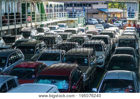 Labuan,Malaysia-June 26,2017:View of vehicles & passengers that use a ferry to cross the South China Sea from Labuan island to Sabah.This is the economical transportation to the Labuan Pearl of Borneo
