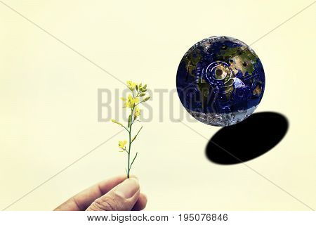 Hands trying to plants give to the world. The world with iron and industry is sinking into the black hole. Element of this image furnished by Nasa. world conservation concept. illustration design.