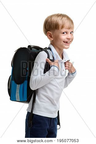 Portrait of happy smiling little boy holding knapsack