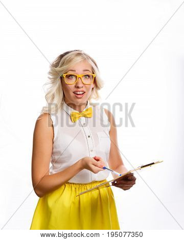 Business woman shows on a check sheet. She is wearing a blouse a bow tie and glasses. The girl is surprised and asks. What happened. The problem is at work. She looks straight ahead.