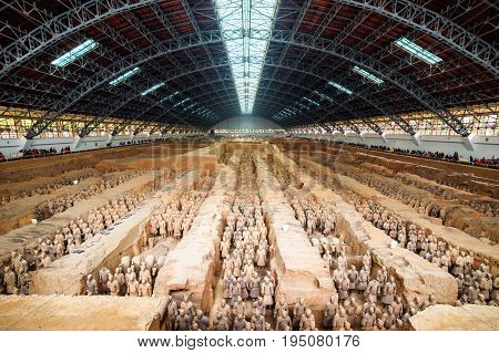 XI'AN SHAANXI PROVINCE CHINA - OCTOBER 28 2015: Main view of corridors with ranks of terracotta soldiers. The Terracotta Army inside the Qin Shi Huang Mausoleum of the First Emperor of China.