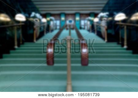 Blurred image. Stairway up with carpet