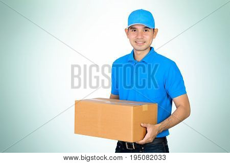Deliveryman carrying a cardboard parcel box on gradient white green background