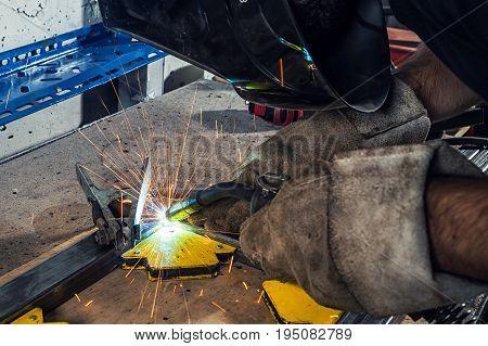 Man Weld A Metal Welding Machine In A Workshop