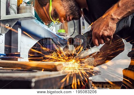 Man Grinding Metal With A Angle Grinder