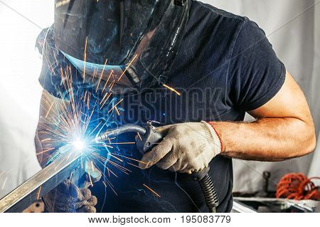 Man Weld  A Metal  With A  Welding Machine