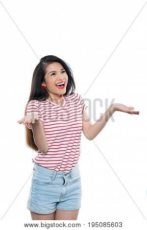 Smiling Vietnamese young woman shrugging her shoulders, isolated on white
