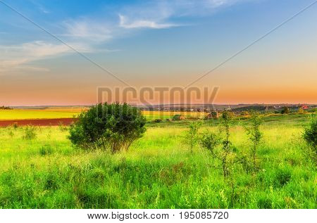 Wide view on russian countryside beneath sky in sunset time
