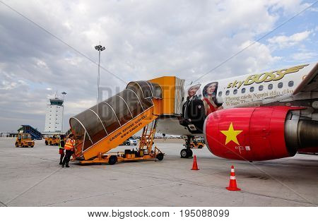 Aircraft Docking At The Airport In Vietnam