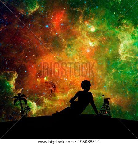 Young woman sunbathing on a beach. Double exposure silhouette of the relaxing girl. Palm and lifeguard tower. Night sky with stars on backdrop. Elements of this image furnished by NASA