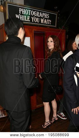 NEW YORK-MAR 31: Actress Julianne Moore enters a photobooth at the CHANEL Paris-Salzburg 2014/15 Metiers d'Art Show and Party at the Park Avenue Armory on March 31, 2015 in New York City.