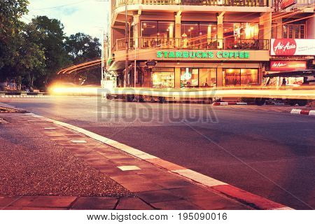 CHIANG MAITHAILAND-JUN 222017 : Starbucks coffee house restaurant entrance signboard at Thapae Road with light of car in Chiang mai Starbucks is the largest global brand.