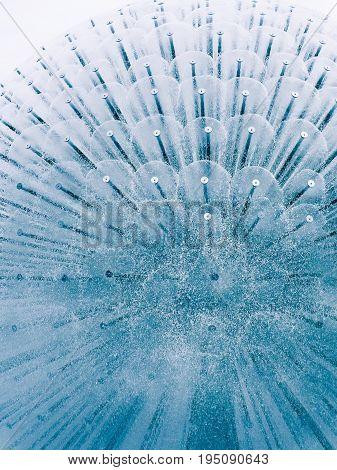Beautiful blue circular fountain on white background