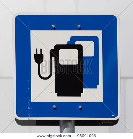 Ecology friendly electric car charging station road sign.