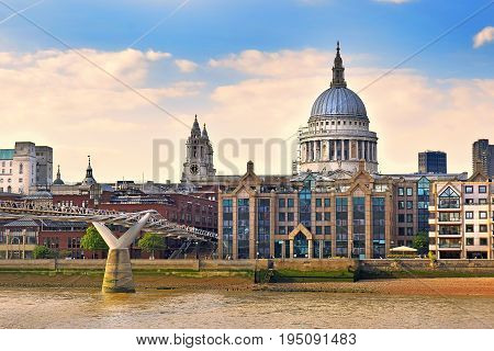 gorgeous view of the Millennium Bridge, St Pauls Cathedral and embankment of the River Thames in good sunny weather, London, UK