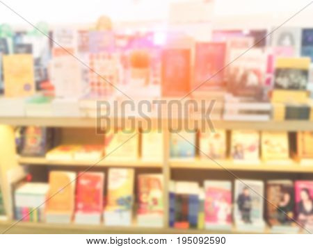 Blur image of a bookstore . with sun light