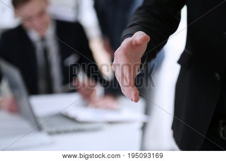 Businesswoman offer hand to shake as hello in office closeup. Serious business friendly support service excellent prospect introduction or thanks gesture gratitude invite to participate concept