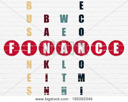 Currency concept: Painted red word Finance in solving Crossword Puzzle