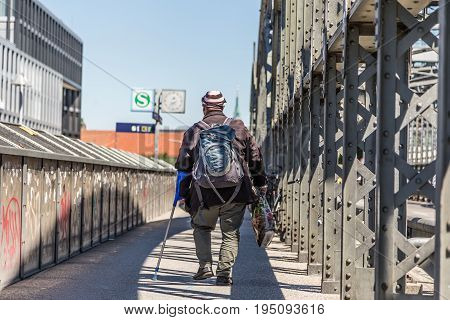 Tramp on Hackerbrucke railway bridge in Munich, Germany.