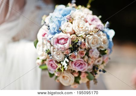 Amazing Wedding Bouquet Made Of Roses, Hydrangeas And Lavender In Bride's Hand.