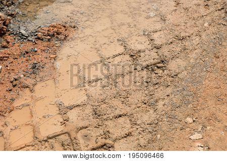 Texture of wheel tracks on the mud road.