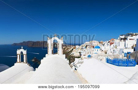 Traditional Greek architecture and a view of the blue sea over a white terrace. Santorini, Cyclades, Greece.