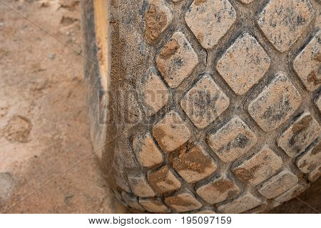 Texture of big truck wheels dirty mess with brown mud