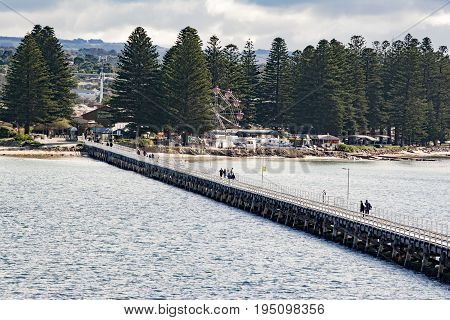 Victor Harbor South Australia: July 10 2017 - People walking over the causeway connecting the township to Granite Island. Part of the Fleurieu Peninsula.