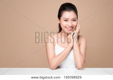 Beauty Face. Facial Treatment. Young Asian Woman With Clean Perfect Skin Touch Her Face.
