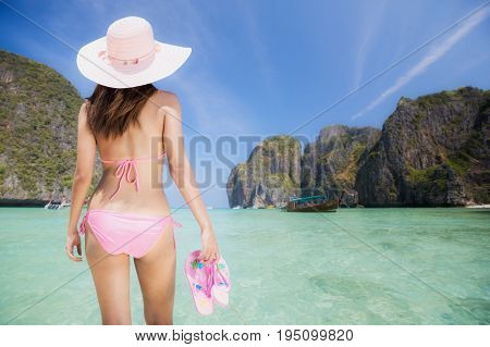 Asian Lady relax in maya beach in phi phi island in Phuket area Thailand Asia summer and travel concept