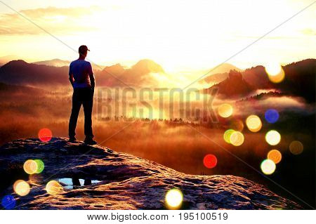 Film Grain. Hiker In Red Cap Stand On The Peak Of Sandstone Rock In Rock Empires Park And Watching O