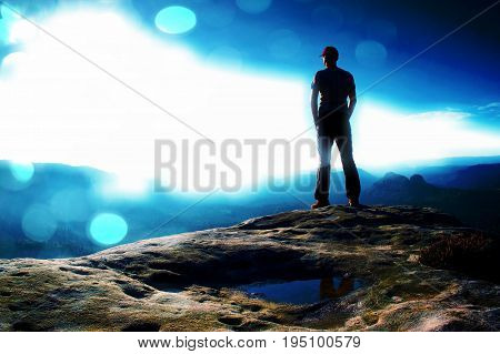 Film Grain. Alone Hiker In Red Cap Stand On The Peak Of Sandstone Rock In Rock Empires Park And Watc