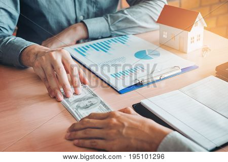 Businessman Giving Money To Business Partner While Making Contract  Concept