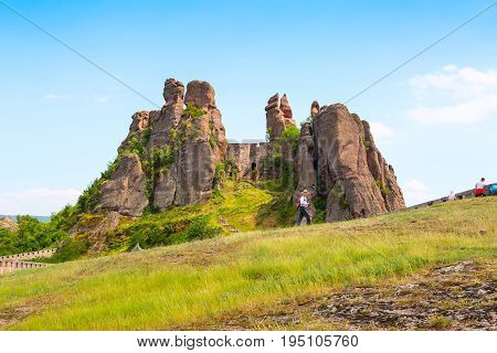 Belogradchik, Bulgaria - May 31, 2016: Belogradchik cliff rocks at ancient Kaleto fortress, Bulgaria and people