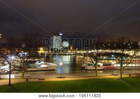 COLOGNE GERMANY - FEBRUARY 21 2016: Night view of embankment in Cologne the largest city in the German federal State of North Rhine-Westphalia and the fourth-largest city in Germany