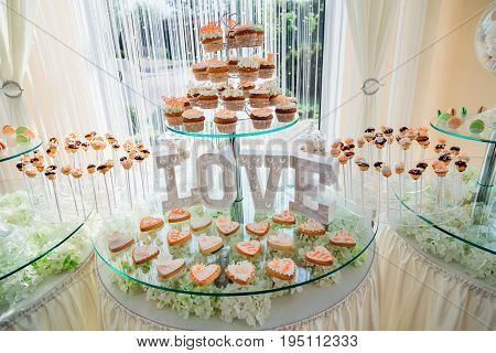 Original Cupcakes Stand Before Lettering Love On The Tired Glass Table