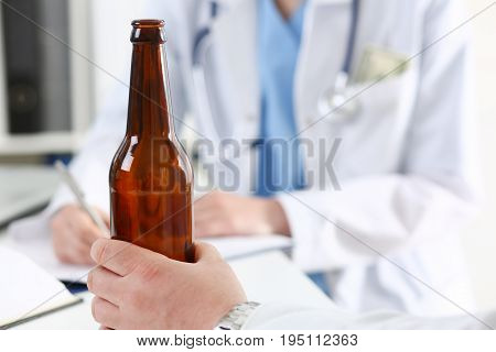 Alcoholic Hold In Hand Empty Bottle At Doctor Reception