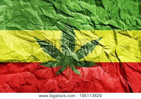 Rasta flag painted on crumpled paper background