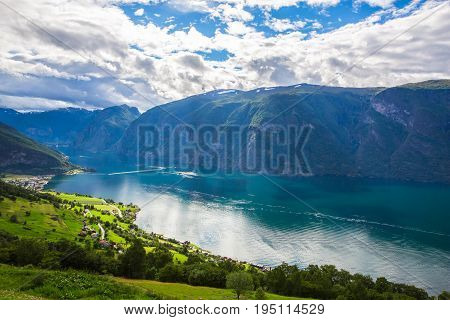 View to Sognefjord in Norway. Small town and cruise port Olden in Norwegian fjords. Bird view of fjord in Norway. under a sunny, blue sky, with the typical rorbu houses. View from the top