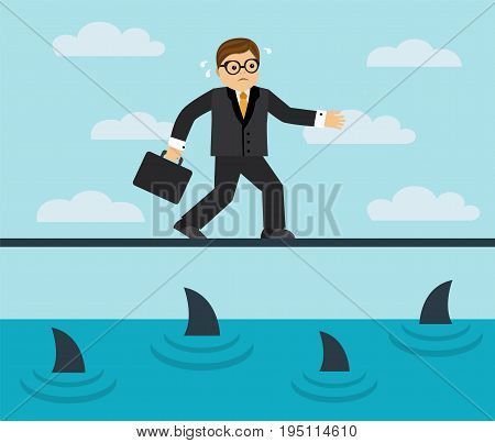 Businessman risks and goes on a tightrope over the sea full of sharks