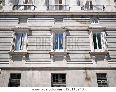 Windows and wall from part of Palacio Real de Madrid or Royal Palace of Madrid in Spain.