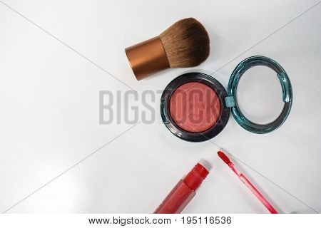 isolated cheek brush and pink brush on with red lip gloss for women beauty